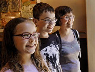 Above: Gillian Lang, right, is with her son, Cameron, 13, and daughter, Hannah, 11 . Jim Beckel