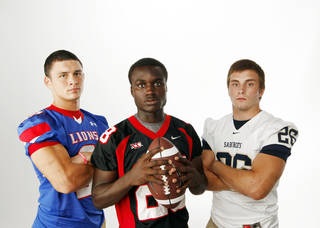 HIGH SCHOOL FOOTBALL ZONE PREVIEW: From left, Brandon Eddins of Moore, Archie Ocloo-Lee of Westmoore and Andrew Long of Southmoore pose for a photo at the OPUBCO studio in Oklahoma City, Saturday, Aug. 20, 2011. Photo by Nate Billings, The Oklahoman ORG XMIT: KOD