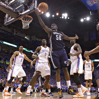 Memphis' Zach Randolph (5) pulls in a rebound in front of the Oklahoma City defense during game one of the Western Conference semifinals between the Memphis Grizzlies and the Oklahoma City Thunder in the NBA basketball playoffs at Oklahoma City Arena in Oklahoma City, Sunday, May 1, 2011. Photo by Chris Landsberger, The Oklahoman