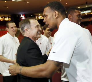 OU men's basketball coach Lon Kruger, left, hugs Romero Osby during a watch party for the NCAA basketball tournament selection show, at Lloyd Noble Center in Norman, Okla., Sunday, March 17, 2013. Oklahoma was selected as the 10th seed in the South Region. Photo by Nate Billings, The Oklahoman