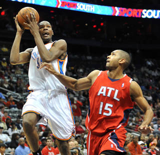 Oklahoma City Thunder's Kevin Durant, left, goes to the basket against Atlanta Hawks' Al Horford (15) in the third quarter of an NBA basketball game in Atlanta, Monday, Jan. 18, 2010. The Thunder won 94-91 and Durant scored 29 points. AP PHOTO