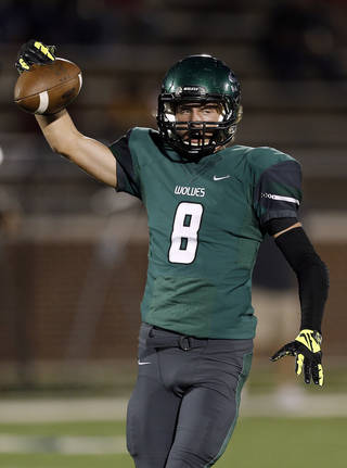 Edmond Santa Fe's Kaden Mendenhall celebrates an interception during the high school football game between Edmond Santa Fe and Mustang at Wantland Stadium in Edmond, Okla., Thursday, Oct. 3, 2013. Photo by Sarah Phipps, The Oklahoman