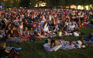 A crowd watches Despicable Me during SONIC Summer Movie Night on the great lawn at the Myriad Gardens, one of several free screenings hosted by the gardens over the summer. Photo by Bryan Terry, The Oklahoman BRYAN TERRY