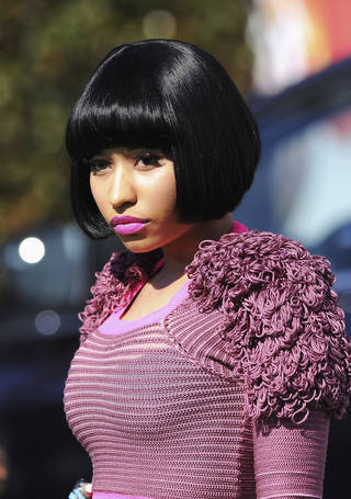 "Artist Nicki Minaj caused the latest controversy with parents and other media advisories after she released the music video and album art for her new single ""Anaconda."" (Jason Merritt, ©istockphoto.com/EdStock)"