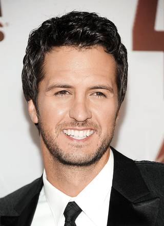 FILE - In this Nov. 9, 2011 file photo, Luke Bryan arrives at the 45th Annual CMA Awards in Nashville, Tenn. Bryan and Eric Church will perform March 30-31 at the Fremont Street Experience, the popular sixth annual show that's free to the public. Bryan will headline Friday's show and Church will handle Saturday. (AP Photo/Evan Agostini, file) ORG XMIT: NYET974