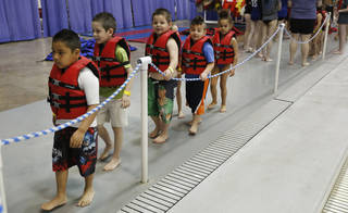 Kindergarten students from Mark Twain Elementary line up to enter the pool at Oklahoma City Community College. Photo By Steve Gooch, The Oklahoman Steve Gooch -