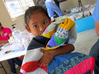 A girl receiving care from People Caring for People, an Oklahoma City nonprofit on a mission trip at the Mexican border. Photos provided