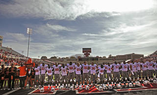 The Oklahoma State football team salutes their fans after the 66-6 win over Texas Tech after the college football game between the Oklahoma State University Cowboys (OSU) and Texas Tech University Red Raiders (TTU) at Jones AT&T Stadium on Saturday, Nov. 12, 2011. in Lubbock, Texas. Photo by Chris Landsberger, The Oklahoman ORG XMIT: KOD