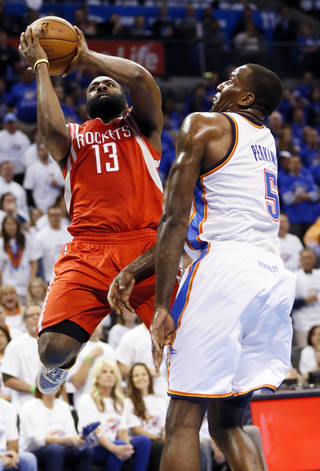 Houston's James Harden (13) shoots against Oklahoma City's Kendrick Perkins (5) during Game 2 in the first round of the NBA playoffs between the Oklahoma City Thunder and the Houston Rockets at Chesapeake Energy Arena in Oklahoma City, Wednesday, April 24, 2013. Photo by Nate Billings, The Oklahoman