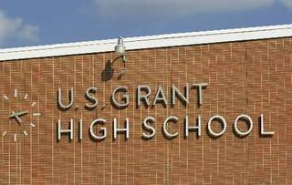 Sign on front of U.S. Grant High School - Staff photo by Jim Beckel - 2001 file photo