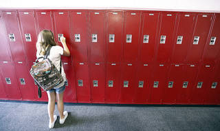 Eight-grader Kaylee Kerr opens her locker at Yukon Middle School, Thursday, August 15, 2013. Photo By Steve Gooch, The Oklahoman