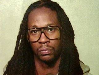 This photo provided by the Oklahoma County Sheriff's Office shows Rapper 2 Chainz. 2 Chainz was one of 11 people arrested after refusing to get off a tour bus for almost nine hours following a traffic stop in Oklahoma City early Thursday morning, Aug. 22, 2013, police said. 2 Chainz, whose real name is Tauheed Epps, was arrested Thursday morning along with 10 other people on a charge of obstructing a police officer, Sgt. Jennifer Wardlow said. (AP Photo/Oklahoma County Sheriff's Office) ORG XMIT: TXKJ105