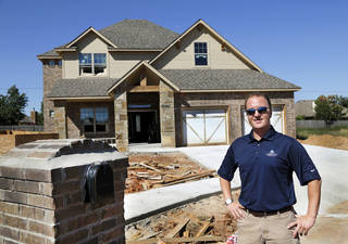 Chad Randall, general manager of Timbercraft Homes, shows one of the company's homes at 17713 Griffin Cove Court, in Griffin Park addition near NW 178 and Western Avenue. The home will be featured in next month's Parade of Homes. Timbercraft owner Jack Evans is chairman of the parade. Jim Beckel - THE OKLAHOMAN