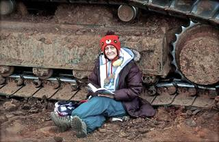 Norman resident Elisabeth Leja chained herself to a track hoe Monday morning to protest the transportation of diluted bitumen from Canada's oil sands. She subsequently was arrested in the incident. Photo provided