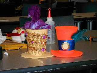 A photo from a Monthly Tea held Sept. 8 at the Downtown Library, where more than 80 people attended. These hats were made by attendees as one of the activities. At OctopodiCon, Bev Hale will be teaching a Makeshop on how to make these tiny top hats. Photo provided.