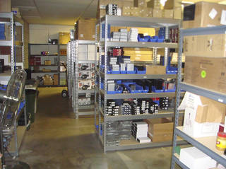 Merchandise of HomeWetBar.com on racks in a previous smaller warehouse leased by the e-commerce retailer. - Provided