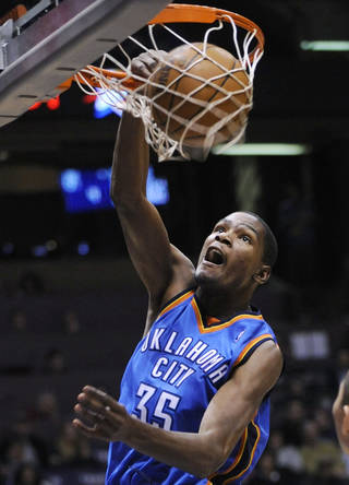 Oklahoma City Thunder forward Kevin Durant dunks during the fourth quarter of an NBA basketball game against the New Jersey Nets on Monday, Dec. 28, 2009, in East Rutherford, N.J. Durant led all scorers with 40 points as the Thunder beat the Nets 105-89. (AP Photo/Bill Kostroun)