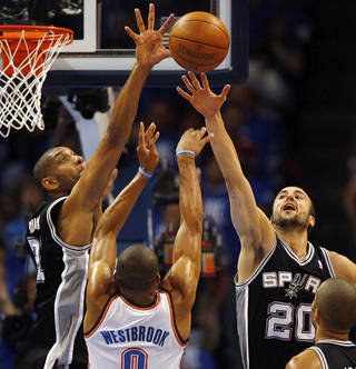 San Antonio's Tim Duncan (21) and Manu Ginobili (20) defend Oklahoma City's Russell Westbrook (0) during Game 3 of the Western Conference Finals between the Oklahoma City Thunder and the San Antonio Spurs in the NBA playoffs at the Chesapeake Energy Arena in Oklahoma City, Thursday, May 31, 2012. Photo by Nate Billings, The Oklahoman