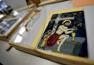 "Religious icons created during the ""Sacred Images: Icons on Glass"" worskhop are displayed during a blessing of the icons ceremony and reception at St. Gregory's University in Shawnee. Photo by Chris Landsberger, The Oklahoman CHRIS LANDSBERGER -"