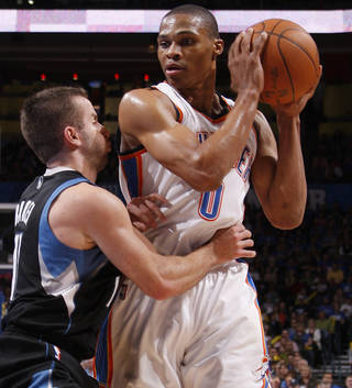 Oklahoma City's Russell Westbrook (0) tries to get past Minnesota's Jose Juan Barea (11) during the NBA basketball game between the Oklahoma City Thunder and the Minnesota Timberwolves at Chesapeake Energy Arena in Oklahoma City, Friday, March 23, 2012. Photo by Bryan Terry, The Oklahoman