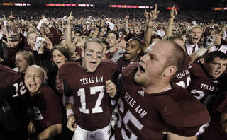 FILE - In this Nov. 20, 2010 file photo, Texas A&M quarterback Ryan Tannehill (17) and Evan Eike (65) celebrate with fans after beating Nebraska 9-6 in an NCAA college football game in College Station, Texas. Texas A&M dealt a blow to the Big 12 Conference on Wednesday, Aug. 31, 2011, saying it plans to leave by July 2012 if it is accepted by the SEC or another league. (AP Photo/David J. Phillip, File)