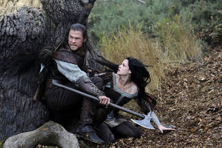 """Chris Hemsworth stars as the Huntsman and Kristen Stewart as Snow White in """"Snow White and the Huntsman."""" UNIVERSAL PICTURES PHOTO"""