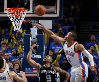 San Antonio's Tony Parker (9) puts up a shot from under Oklahoma City's Russell Westbrook (0) during Game 3 of the Western Conference Finals in the NBA playoffs between the Oklahoma City Thunder and the San Antonio Spurs at Chesapeake Energy Arena in Oklahoma City, Sunday, May 25, 2014. Photo by Bryan Terry, The Oklahoman