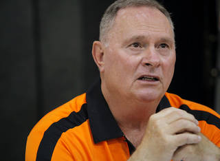 OSU dffensive coordinator Bill Young speaks to the media during Media Day at Gallagher-Iba Arena on the Oklahoma State University campus in Stillwater on Saturday, Aug. 6, 2011. Photo by John Clanton, The Oklahoman