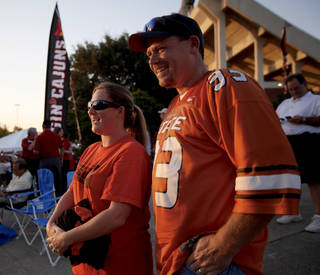 David and Christy Hooks stand outside the stadium before the football game between the University of Louisiana-Lafayette and Oklahoma State University at Cajun Field in Lafayette, La., Friday, October 8, 2010. Photo by Bryan Terry, The Oklahoman
