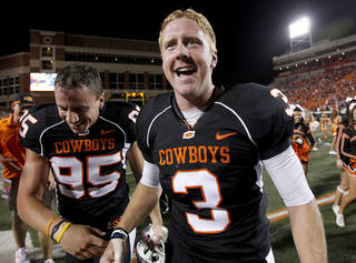 OSU's Brandon Weeden (3) celebrates with kicker Dan Bailey in the air following the college football game between Texas A&M University (TAMU) and Oklahoma State University (OSU) at Boone Pickens Stadium in Stillwater, Okla., Thursday, Sept. 30, 2010. Photo by Sarah Phipps, The Oklahoman