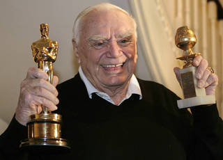 FILE - In this Jan. 13, 2008, file photo, actor Ernest Borgnine displays for a television crew, his Golden Globe, right, and Oscar awards he received in 1956 for the movie 'Marty' in Beverly Hills, Calif. A spokesman said Sunday, July 8, 2012, that Borgnine has died at the age of 95. (AP Photo/Ric Francis, File) ORG XMIT: NY804