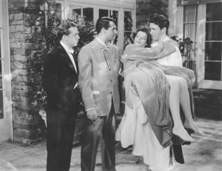 "From left, John Howard, Cary Grant, Katharine Hepburn and James Stewart are shown in a scene from ""The Philadelphia Story."" MGM photo."