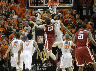 Oklahoma State's Markel Brown (22) defends against Oklahoma's Ryan Spangler (00) during the men's Bedlam college game between Oklahoma and Oklahoma State at Gallagher-Iba Arena in Stillwater, Okla., Saturday, Feb. 15, 2014. Photo by Sarah Phipps, The Oklahoman
