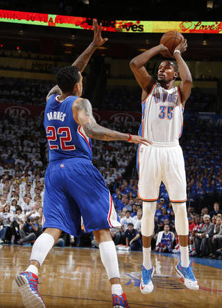 Kevin Durant (35) shoots over Matt Barnes (22) during Game 2 of the Western Conference semifinals in the NBA playoffs between the Oklahoma City Thunder and the Los Angeles Clippers at Chesapeake Energy Arena in Oklahoma City, Wednesday, May 7, 2014. Photo by Bryan Terry, The Oklahoman