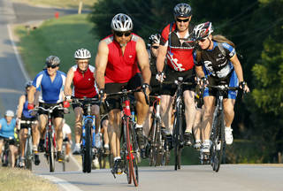 Riders head east on Robinson Street during last year's Norman Conquest bicycle ride that benefits the J.D. McCarty Center. PHOTO BY STEVE SISNEY, THE OKLAHOMAN ARCHIVES STEVE SISNEY -