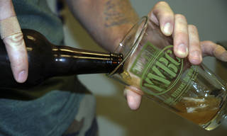 In a Wednesday, Aug. 14, 2013, photo, Young Veterans Brewing Co. president and Iraq War veteran Thomas Wilder pours a glass of ¬¨a¨Jet Noise IPA,¬¨aÆ at the Virginia Beach, Va., brewery. The brewery set to open in September in military-heavy Hampton Roads is part of a growing number of craft breweries popping up throughout Virginia and the country. Virginia, which is celebrating its second craft beer month in August, has seen the industry grow from about 40 craft breweries last year to more than 60 in 2013, with countless more in the works. ORG XMIT: RIC103