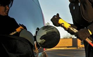 In this archive photo, Sundee Busby prepares to attach the pump as she fills her Chevrolet Tahoe at a natural gas pump located at the OnCue Express on Jan. 11 in Edmond. CHRIS LANDSBERGER - CHRIS LANDSBERGER