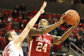Oklahoma's Romero Osby shoots against Texas Tech's Robert Lewandowski during their NCAA college basketball game in Lubbock, Texas, Saturday, Feb. 11, 2012. (AP Photo/Lubbock Avalanche-Journal, Zach Long) ALL LOCAL TV OUT ORG XMIT: TXLUB101