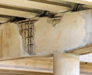 At right: A deteriorated area under a Belle Isle bridge. NATE BILLINGS -