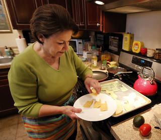 Sherrel Jones shows how she makes Oklahoma-shaped chips from corn and flour tortillas.