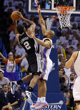 Oklahoma City's Derek Fisher (6) defends against San Antonio's Kawhi Leonard (2) during Game 6 of the Western Conference Finals in the NBA playoffs between the Oklahoma City Thunder and the San Antonio Spurs at Chesapeake Energy Arena in Oklahoma City, Saturday, May 31, 2014. Photo by Bryan Terry, The Oklahoman