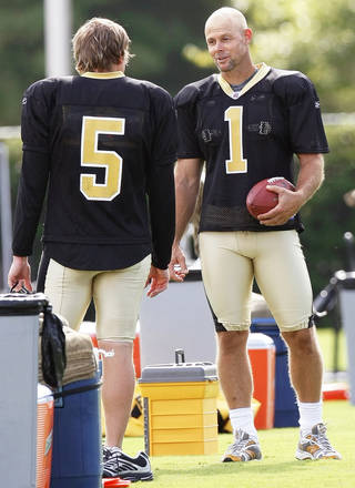 The Saints' John Carney, right, talks with fellow placekicker Garrett Hartley, a former OU player, at the morning practice session in Metairie on Sunday. It was Carney's first practice since signing a contract with the Saints. AP Photo
