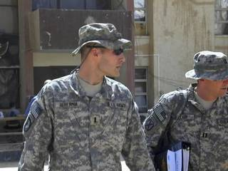 2008 file photo - 1st Lt. Michael C. Behenna, left, and his defense attorney Capt. Tom Clark, right, walk in Camp Speicher, a large U.S. base near Tikrit, north of Baghdad, Iraq, Sunday, Sept. 21, 2008. (AP Photo/Vanessa Gera)