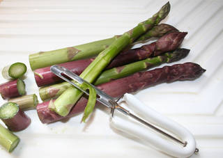 Spring rains may make it necessary to use a vegetable peeler to remove some of the lower leaflets along asparagus stems. These tend to pick up tiny bits of soil during heavy spring rains as the asparagus works its way up through the soil. Trim the bottoms of the asparagus to keep the spears at a uniform length then use the peeler to slice away the leaflets before cooking. SHERREL JONES - THE OKLAHOMAN