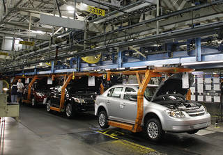 The Chevy Cobalt moves on the assembly line at the Lordstown Assembly Plant in 2008 in Lordstown, Ohio. The U.S. is looking into GM's delayed report. AP File Photo Ron Schwane - AP