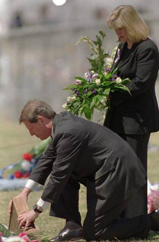 On the first anniversary of the 1995 bombing, then-Vice President Al Gore lays an American flag on the area where the Alfred P. Murrah Federal Building once stood. Holding the flowers is his wife, Tipper. AP file PhotO DAVID L. LONGSTREATH - AP - Associated Press