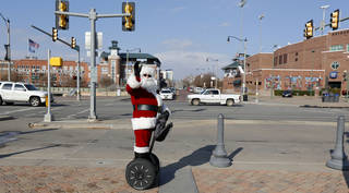 The Sonic Segway Santa waves to visitors in Bricktown in Oklahoma City, Friday December 13, 2013. Photo By Steve Gooch, The Oklahoman