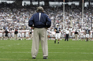 "FILE - In this Sept. 6, 2008 file photo, Penn State coach Joe Paterno surveys the field before an NCAA college football game against Oregon State at Beaver Stadium in State College, Pa. NCAA president Mark Emmert says he isn't ruling out the possibility of shutting down the Penn State football program in the wake of the Jerry Sandusky child sex abuse scandal. In a PBS interview Monday night, July 16, 2012, he said he doesn't want to ""take anything off the table"" if the NCAA determines penalties against Penn State are warranted. (AP Photo/Carolyn Kaster, File) ORG XMIT: NY160"