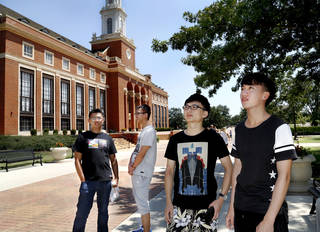 International students, from left, Steve Jian, Peng Yu, Felix Huang and Yun Ye Gou, stand outside the Edmon Low Library last week as they become familiar with the Oklahoma State University campus. The students are freshmen from China pursuing degrees in finance and business. Photo by Jim Beckel, The Oklahoman Jim Beckel - THE OKLAHOMAN