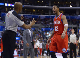 Philadelphia 76ers forward Evan Turner, right, yells at referee Tre Maddox after receiving a technical foul during the first half of an NBA basketball game against the Los Angeles Clippers, Sunday, Feb. 9, 2014, in Los Angeles. (AP Photo/Mark J. Terrill)